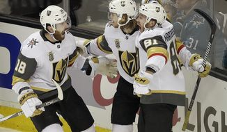 Vegas Golden Knights center William Karlsson, center, from Sweden, celebrates with left wing James Neal (18) and center Jonathan Marchessault (81) after scoring the winning goal against the San Jose Sharks during overtime of Game 3 of an NHL hockey second-round playoff series in San Jose, Calif., Monday, April 30, 2018. The Golden Knights won 4-3. (AP Photo/Jeff Chiu)