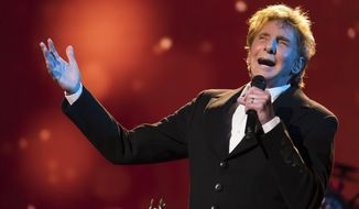 """FILE - In this April 19, 2017 file photo, Barry Manilow performs at the world premiere of """"Clive Davis: The Soundtrack of Our Lives"""" during the 2017 Tribeca Film Festival in New York. Manilow is returning to Las Vegas for a serious of regular shows starting in May at the Westgate Las Vegas Resort & Casino. Tickets for Manilow's 85-minute show celebrating his greatest hits such as """"Mandy"""" and """"Can't Smile Without You"""" go on sale Wednesday, May 2, 2018. (Photo by Charles Sykes/Invision/AP, File)"""