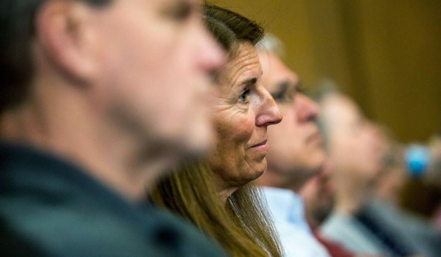 """Crash survivor Sheila Jeske reacts to the defense's closing argument that much of the prosecution's evidence is """"speculation"""" during Charles Pickett's murder trial, Tuesday, May 1, 2018, in Kalamazoo, Mich. Jurors in Michigan heard closing arguments in the case of Pickett, a man charged with second-degree murder in the deaths of five bicyclists who were killed while riding on a rural road.  (Rebekah Welch /Kalamazoo Gazette-MLive Media Group via AP)"""