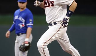 Minnesota Twins' Joe Mauer rounds the bases on a solo home run off Toronto Blue Jays' pitcher Marco Estrada during the first inning of a baseball game Tuesday, May 1, 2018, in Minneapolis. (AP Photo/Jim Mone)