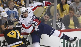 Pittsburgh Penguins' Chad Ruhwedel (2) collides with Washington Capitals' Tom Wilson (43) during the first period in Game 3 of an NHL hockey second-round playoff series in Pittsburgh, Tuesday, May 1, 2018. (AP Photo/Gene J. Puskar) **FILE**