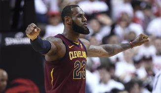 Cleveland Cavaliers forward LeBron James celebrates after the Cavaliers defeated the Toronto Raptors in Game 1 of an NBA basketball playoffs Eastern Conference semifinal, Tuesday, May 1, 2018, in Toronto. (Nathan Denette/The Canadian Press via AP)