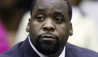 FILE - In this May 25, 2010 file photo, former Detroit Mayor Kwame Kilpatrick sits in a Detroit courtroom. The amount of money owed by imprisoned ex-Detroit Mayor Kwame Kilpatrick continues to increase. A federal judge has ordered Kilpatrick and friends Derrick Miller and Bobby Ferguson to pay a contractor more than $7.4 million for profits lost to bid-rigging on water department contracts. (AP Photo/Paul Sancya, File)