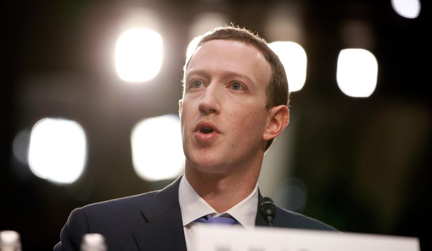 In this April 10, 2018, file photo, Facebook CEO Mark Zuckerberg testifies before a joint hearing of the Commerce and Judiciary Committees on Capitol Hill in Washington about the use of Facebook data to target American voters in the 2016 election. (AP Photo/Alex Brandon)