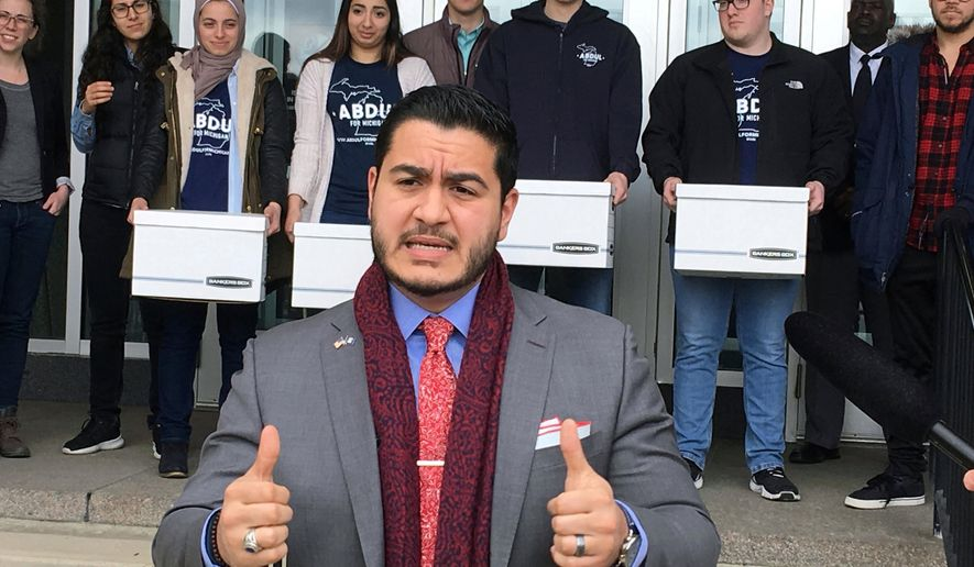 """FILE - In this March 6, 2018, file photo, Democratic gubernatorial candidate Abdul El-Sayed speaks before submitting nominating petitions to the Michigan Bureau of Elections, in Lansing, Mich. El-Sayed launched his first TV ad in the Michigan governor's race Tuesday, May 1, 2018, touting his work to protect public health while calling for """"new blood"""" in Lansing. (AP Photo/David Eggert File)"""