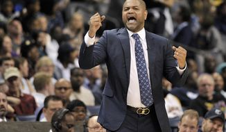 FILE - In this March 24, 2018, file photo, Memphis Grizzlies interim head coach J.B. Bickerstaff reacts in the second half of an NBA basketball game against the Los Angeles Lakers  in Memphis, Tenn. The Grizzlies have decided to take the interim tag off and keep J.B. Bickerstaff around as their head coach.(AP Photo/Brandon Dill, File)