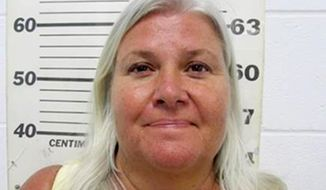 FILE - This file photo provided by the South Padre Island Police Department shows Lois Riess, of Blooming Prairie, Minn., who was arrested by federal deputy marshals April 19, 2018, at a restaurant in South Padre Island, Texas in connection with the killings of two people in separate states, including her husband. Authorities say Riess, a Minnesota grandma, who led authorities on a cross-country manhunt after she allegedly killed her husband took steps to conceal a second death in Florida. New details in the case of Riess detail her steps in Fort Myers, Fla., where she allegedly killed a woman because she wanted to assume her identity. (South Padre Island Police Department via AP, File)