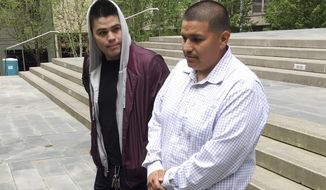 Daniel Ramirez Medina, right, walks with a man identified as his brother following a hearing in U.S. District Court in Seattle on Tuesday, May 1, 2018. Ramirez is asking U.S. District Judge Ricardo S. Martinez to block the government from revoking his participation in the Deferred Action for Childhood Arrivals program, which allows those brought to the U.S. illegally as children to remain in the country to work or study. (AP Photo/Gene Johnson)