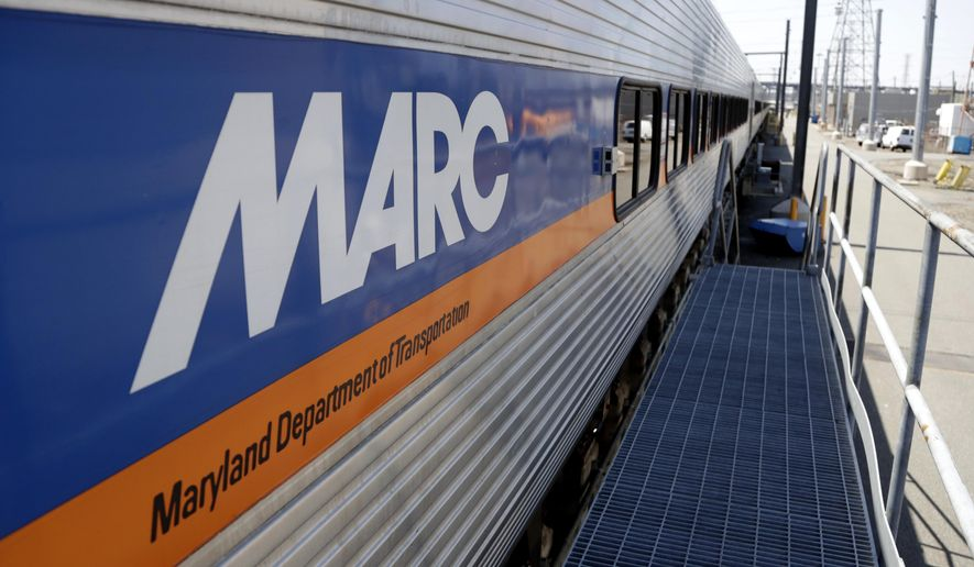 A Maryland Transit Administration's MARC commuter train wagon sits on an inspection track at New Jersey Transit's Meadows Maintenance Complex, Tuesday, May 1, 2018, in Kearny, N.J. (AP Photo/Julio Cortez) ** FILE **