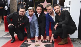 Chris Kirkpatrick, from left, Lance Bass, JC Chasez, Joey Fatone and Justin Timberlake attend a ceremony honoring NSYNC with a star on the Hollywood Walk of Fame on Monday, April 30, 2018, in Los Angeles. (Photo by Jordan Strauss/Invision/AP)