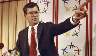FILE - In this 1990 file photo, Billy Payne takes questions at an Olympic news conference on the city's bid to host the games in Atlanta. Payne led the bid to bring the Olympics to Atlanta in 1996. While his name doesn't roll off the tongue of the average fan, nothing more is needed to assure that William Porter Payne will go down as one of the most influential people in modern American sports. (Dwight Ross Jr./Atlanta Journal-Constitution via AP, file)