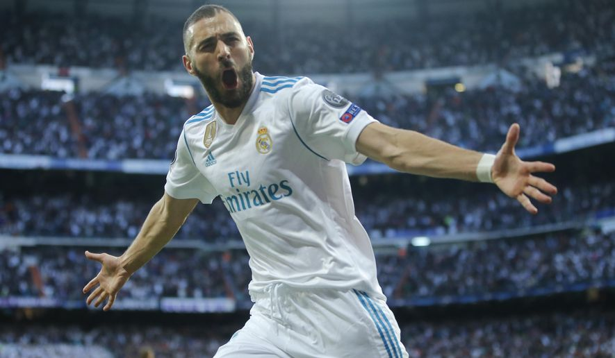 Real Madrid's Karim Benzema celebrates after scoring his side's opening goal during the Champions League semifinal second leg soccer match between Real Madrid and FC Bayern Munich at the Santiago Bernabeu stadium in Madrid, Spain, Tuesday, May 1, 2018. (AP Photo/Paul White)