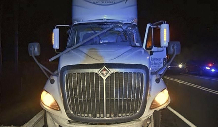 This photo provided by the Pennsylvania State Police shows a truck's windshield damaged by a 10-foot section of electrical conduit that struck the driver in the head, killing him, on Feb. 21, 2018. The conduit broke away from the ceiling of the Lehigh Tunnel along the Pennsylvania Turnpike in East Penn Township, Carbon County, Pa. In a preliminary report issued Tuesday, May 1, 2018, by the National Transportation Safety Board, federal investigators say steel straps holding electrical conduits to the tunnel's ceiling had corroded before the accident that killed 70-year-old Howard Sexton III, of Mickleton, N.J. (Pennsylvania State Police via National Transportation Safety Board via AP)