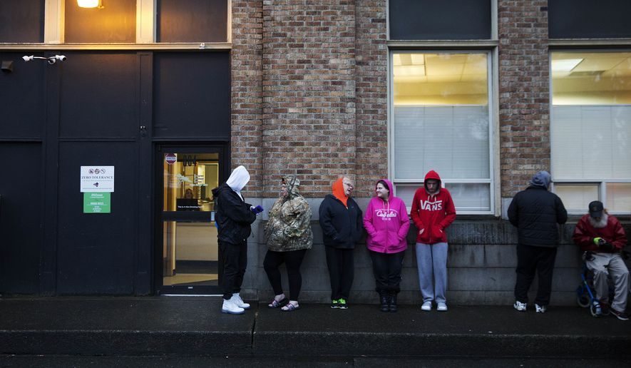 People wait in line for the Evergreen Treatment Services methadone clinic to open in Hoquiam, Wash., Thursday, June 15, 2017. Penn State sociologist Shannon Monnat spent last fall plotting places on a map experiencing a rise in deaths of despair _ from drugs, alcohol and suicide wrought by the decimation of jobs that used to bring dignity. On Election Day, a television map of Trumps victory looked eerily similar to hers documenting death, from New England through the Rust Belt all the way here, to the rural coast of Washington. (AP Photo/David Goldman)