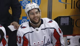 Washington Capitals' Tom Wilson sits on the bench after colliding with with Pittsburgh Penguins' Zach Aston-Reese (46) during the second period in Game 3 of an NHL second-round hockey playoff series in Pittsburgh, Tuesday, May 1, 2018. Aston-Reese suffered a broken jaw and will miss the rest of the playoffs. The Capitals won 4-3. (AP Photo/Gene J. Puskar)