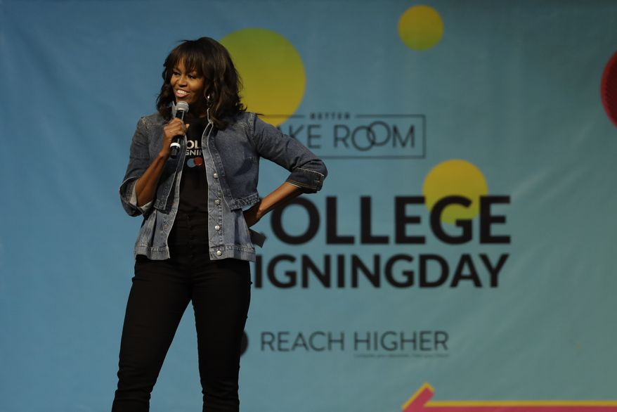 Michelle Obama speaks at College Signing Day, an event honoring Philadelphia students for their pursuit of a college education or career in the military, Wednesday, May 2, 2018, at Temple University in Philadelphia. (AP Photo/Matt Slocum)