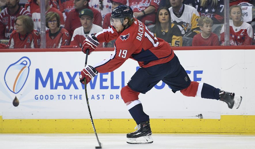 Washington Capitals center Nicklas Backstrom (19), of Sweden, skates with the puck during the first period in Game 2 of an NHL second-round hockey playoff series against the Pittsburgh Penguins, Sunday, April 29, 2018, in Washington. (AP Photo/Nick Wass)