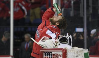 Washington Capitals goaltender Braden Holtby (70) douses himself before Game 2 of an NHL second-round hockey playoff series against the Pittsburgh Penguins, Sunday, April 29, 2018, in Washington. (AP Photo/Nick Wass) ** FILE **