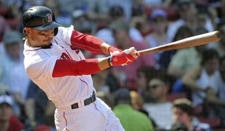 Boston Red Sox's Mookie Betts hits his third home run of the game in the seventh inning in a baseball game against the Kansas City Royals, at Fenway Park, Wednesday, May 2, 2018, in Boston. (AP Photo/Elise Amendola)
