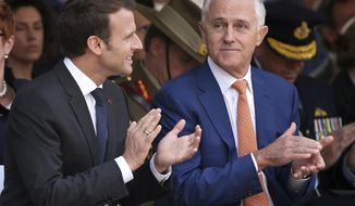 French President Emmanuel Macron, left, and Australian Prime Minister Malcolm Turnbull clap during a war commemorative ceremony in Sydney, Wednesday, May 2, 2018. Macron is on a three-day visit to Australia. (AP Photo/Rick Rycroft, Pool)