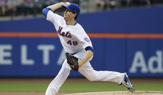 New York Mets' Jacob deGrom delivers a pitch during the first inning of the team's baseball game against the Atlanta Braves on Wednesday, May 2, 2018, in New York. (AP Photo/Frank Franklin II)