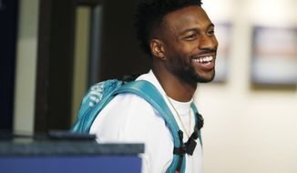 Denver Broncos wide receiver Emmanuel Sanders jokes with reporters after a news conference at the NFL football team's headquarters Wednesday, May 2, 2018, in Englewood, Colo. (AP Photo/David Zalubowski)
