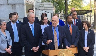 District of Columbia City Council President Phil Mendelson speaks during an impromptu news conference outside City Hall, Tuesday, May 1, 2018, in Washington, as other council members listen.  (AP Photo/Ashraf Khalil) **FILE**