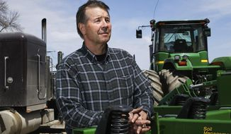 Bruce Schmoll is back at work on his family's farm near Claremont, Minn., after suffering a stroke in March. (Andrew Link/The Rochester Post-Bulletin via AP)
