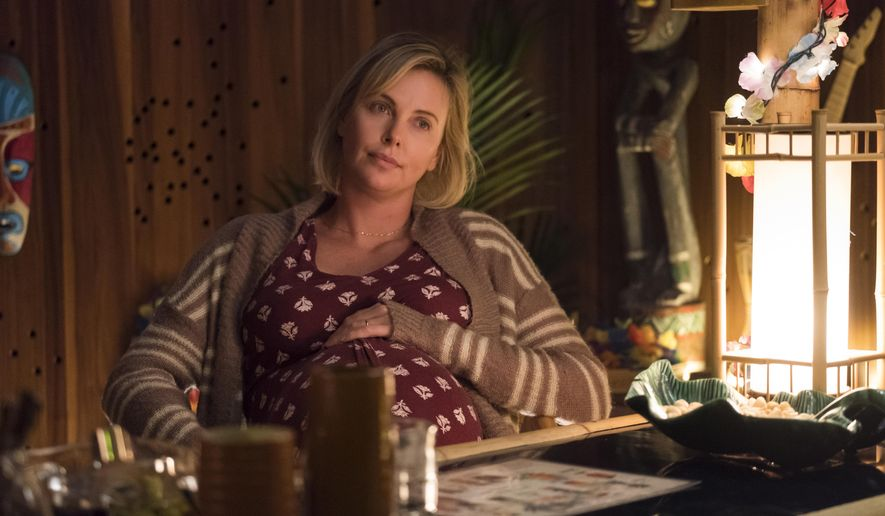 """This image released by Focus Features shows Charlize Theron in a scene from """"Tully."""" (Kimberly French/Focus Features via AP)"""