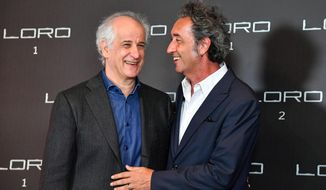 "Italian director Paolo Sorrentino and actor Toni Servillo, left, share a laugh during the photocall of Sorrentino's latest film ""Loro 2"", in Rome, Wednesday, May 2, 2018. The movie will open in Italian cinemas on May 10. (Alessandro Di Meo/ANSA via AP)"