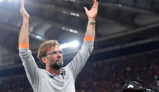 Liverpool coach Jurgen Klopp celebrates at the end of the Champions League semifinal second leg soccer match between Roma and Liverpool at the Olympic Stadium in Rome, Wednesday, May 2, 2018. Liverpool advanced to its first Champions League final in more than a decade despite a 4-2 loss at Roma on Wednesday. The Reds scored two early goals and that was all they needed to advance 7-6 on aggregate after a 5-2 win in the first leg. (Ettore Ferrari/ANSA via AP)