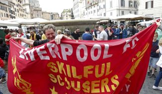 Liverpool fans holds a banner before the Champions League semifinal second leg soccer match between Liverpool and AS Roma, scheduled at the Olympic stadium, in Rome, Wednesday, May 2, 2018. (AP Photo/Riccardo De Luca)