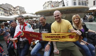 Liverpool fans holds a scarf before the Champions League semifinal second leg soccer match between Liverpool and AS Roma, scheduled at the Olympic stadium, in Rome, Wednesday, May 2, 2018. (AP Photo/Riccardo De Luca)
