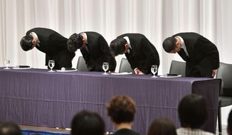 Members of Japan's pop group Tokio, from left, Tomoya Nagase, Taichi Kokubun, Shigeru Joshima and Masahiro Matsuoka bow during a press conference on another member's sexual harassment in Tokyo Wednesday, May 2, 2018. Tatsuya Yamaguchi of the group, who acknowledged last week he had sexually harassed a teenage woman, tendered his resignation. Tokio leader Joshima said Yamaguchi apologized to the other members and submitted his resignation Monday night, but there was no immediate decision whether to accept it and the group won't disband. (Muneyuki Tomari/Kyodo News via AP)