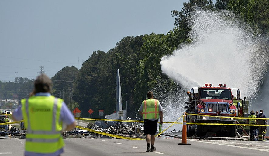 A firetruck sprays foam over the remains of an Air National Guard C-130 cargo plane from Puerto Rico that crashed near the intersection of state highway Georgia 21 and Crossgate Road in Port Wentworth, Ga., Wednesday, May 2, 2018. (Steve Bisson/Savannah Morning News via AP) ** FILE **