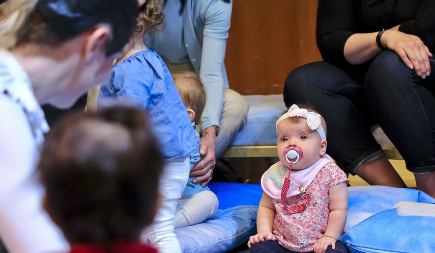 """Seven-month-old Stella Starwalt listens to a performance of """"BambinO,"""" a Scottish opera designed for an audience that is 6 to 18 months old, Tuesday May 1, 2018, at the Metropolitan Opera House in New York. (AP Photo/Bebeto Matthews) ** FILE **"""