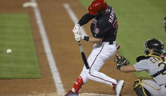 Washington Nationals' Bryce Harper hits a three-run homer off Pittsburgh Pirates starting pitcher Chad Kuhl during the fifth inning of a baseball game at Nationals Park, Tuesday, May 1, 2018, in Washington. Behind the plate is Pirates catcher Francisco Cervelli. (AP Photo/Pablo Martinez Monsivais)