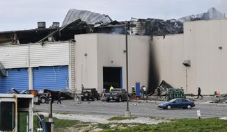 Emergency personnel work at the scene of a fire at Meridian Magnesium Products of America in Eaton Rapids, Mich., Wednesday morning, May 2, 2018. Authorities said explosions and a large fire at the auto parts plant injured a couple people and forced the evacuation of workers. (Matthew Dae Smith/Lansing State Journal via AP)