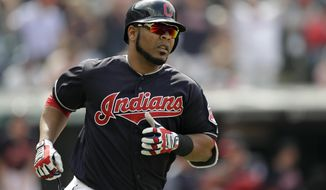Cleveland Indians' Edwin Encarnacion runs the bases after hitting a solo home run off Texas Rangers relief pitcher Jesse Chavez in the eighth inning of a baseball game, Wednesday, May 2, 2018, in Cleveland. The Indians won 12-4. (AP Photo/Tony Dejak)