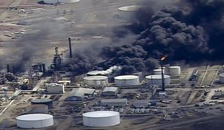 FILE - In this April 26, 2018, file frame from video smoke rises from the Husky Energy oil refinery after an explosion and fire at the plant in Superior, Wis. The mayors of the Lake Superior twin port cities near last week's explosion and fire are calling on its owners to stop using a dangerous chemical compound at the site. Husky Energy is one of about 50 refineries in the country that still uses hydrogen fluoride to process high-octane gasoline. (KSTP-TV via AP, File)