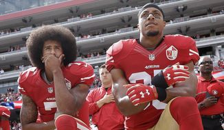 FILE - In this Oct. 2, 2016, file photo, San Francisco 49ers quarterback Colin Kaepernick, left, and safety Eric Reid kneel during the national anthem before an NFL football game against the Dallas Cowboys in Santa Clara, Calif. The NFL players' union says former San Francisco 49ers safety Eric Reid filed a grievance against the league, alleging that he remains unsigned as a result of collusion by owners. Reid had joined former teammate Colin Kaepernick two seasons ago in kneeling during the national anthem to protest police brutality and racial inequality. (AP Photo/Marcio Jose Sanchez, File)