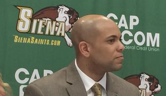 Jamion Christian is introduced Wednesday May 2, 2018, as the new Siena men's basketball coach at Times Union Center in downtown Albany, N.Y. Christian, who has spent the past six seasons as head coach at his alma mater, Mount St. Mary's, replaces Jimmy Patsos, the school announced Wednesday. (AP Photo/John Kekis)