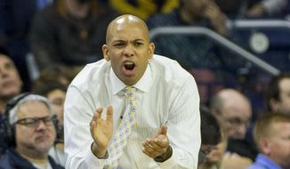 FILE - In this Nov. 13, 2017, file photo, Mount St. Mary's head coach Jamion Christian tries to pump up his players during the second half of an NCAA college basketball game against Notre Dame, in South Bend, Ind. Siena has hired Jamion Christian to replace Jimmy Patsos as its men's basketball coach. The school announced the move Wednesday, May 2, 2018. Christian spent the past six seasons as head coach at his alma mater, Mount St. Mary's.  (AP Photo/Robert Franklin, File) **FILE**