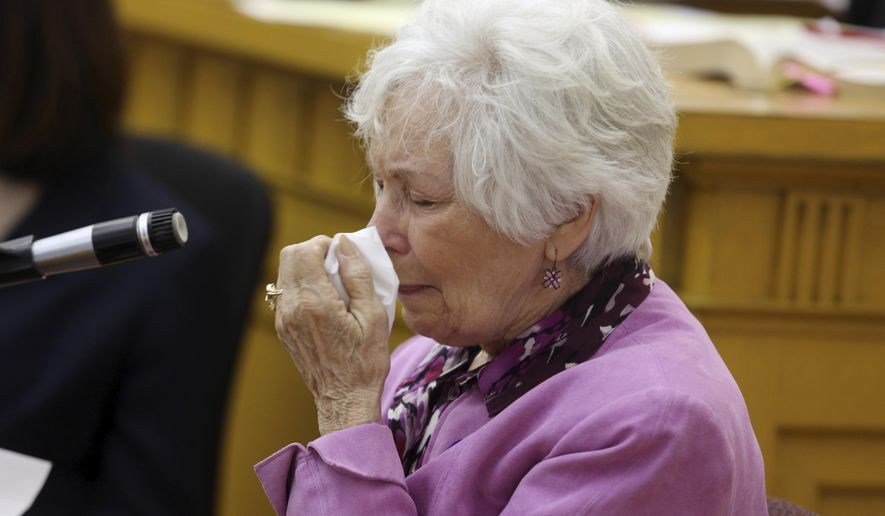 Donna Forshee, Elizabeth Syperda's mother becomes emotional as she testifies during the first day of Michael Syperda's first-degree murder trial in the death of his estranged wife, who disappeared from a residence she was sharing with a woman in Mount Pleasant, Iowa, in 2000, Tuesday May 1, 2018 at the Henry County District Court in Mount Pleasant. The body of the 22-year-old Elizabeth Syperda has never been found. She has not been seen or heard from since the day she disappeared. ( John Lovretta/The Hawk Eye via AP)