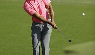 Tiger Woods chips to the 10th hole during the pro-am of the Wells Fargo Championship golf tournament at Quail Hollow Club in Charlotte, N.C., Wednesday, May 2, 2018. (AP Photo/Chuck Burton)