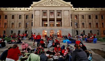 Teachers camp out as the Arizona legislature debates a budget negotiated by majority Republicans and GOP Gov. Doug Ducey Thursday, May 3, 2018, at the Capitol in Phoenix. The budget gives teachers big raises but falls short of their demands for better school funding. The teachers, in the sixth day of walk outs, have agreed to return to the classroom once the budget has been approved by the legislature.(AP Photo/Matt York) (ASSOCIATED PRESS)