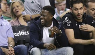 Actor and comedian Kevin Hart laughs during the first quarter of Game 2 of an NBA basketball second-round playoff series between the Boston Celtics and the Philadelphia 76ers, Thursday, May 3, 2018, in Boston. (AP Photo/Elise Amendola)