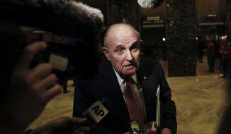 Former New York City Mayor Rudy Giuliani speaks to media at Trump Tower, Tuesday, Nov. 22, 2016, in New York. (AP Photo/Carolyn Kaster)