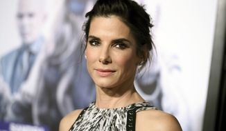 """This Oct. 26, 2015, file photo shows actress Sandra Bullock arrives at the premiere of """"Our Brand is Crisis"""" in Los Angeles. (Photo by Richard Shotwell/Invision/AP, File)"""