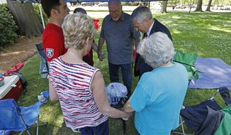 Attendees take advantage of a prayer tent to offer prayers at a daylong National Day of Prayer service at the Mississippi State Capitol in Jackson, Miss., Thursday, May 3, 2018. (AP Photo/Rogelio V. Solis)
